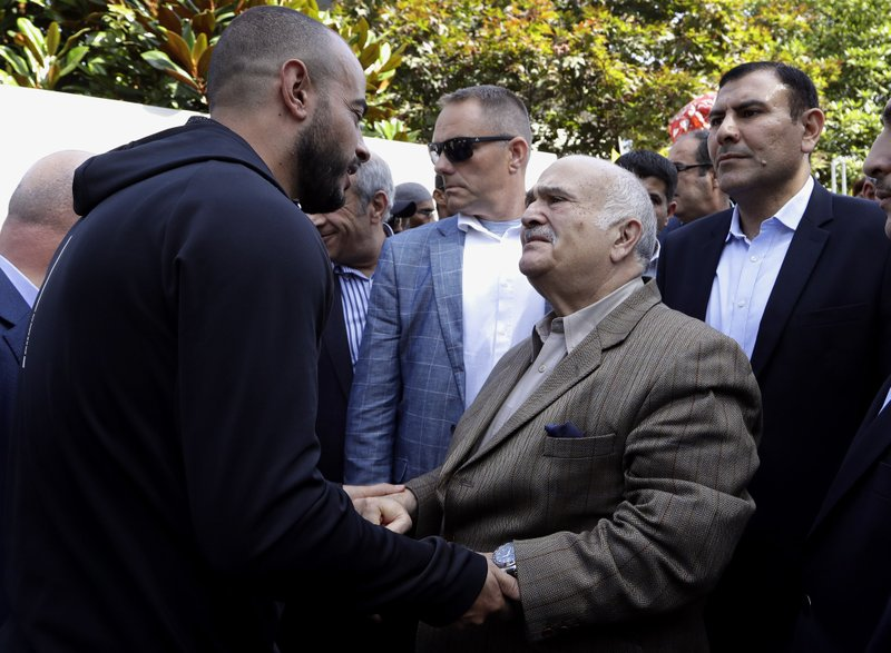 His Royal Highness Prince El Hassan bin Talal Hashemite, second right, of the Kingdom of Jordan greets a worshipper outside the Al Noor mosque in Christchurch, New Zealand, Saturday, March 23, 2019. (AP Photo/Mark Baker)