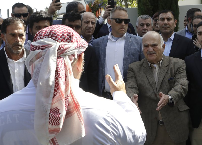 His Royal Highness Prince El Hassan bin Talal Hashemite, second right, of Jordan, greets a worshipper who had just performed a haka outside the Al Noor mosque in Christchurch, New Zealand, Saturday, March 23, 2019. (AP Photo/Mark Baker)