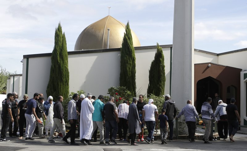 Worshippers prepare to enter the Al Noor mosque following last week's mass shooting in Christchurch, New Zealand, Saturday, March 23, 2019. (AP Photo/Mark Baker)