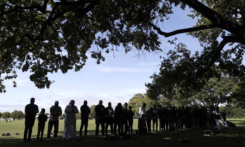 Muslim men pray in Hagley Park across the road from the Al Noor mosque following last week's mass shooting in Christchurch, New Zealand, Saturday, March 23, 2019. (AP Photo/Mark Baker)