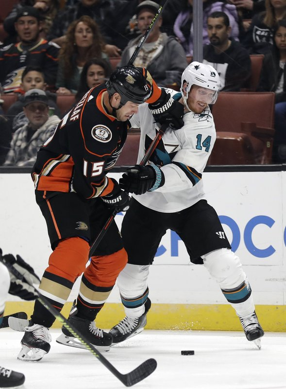 Anaheim Ducks' Ryan Getzlaf (15) collides with San Jose Sharks' Gustav Nyquist (14) during the second period of an NHL hockey game Friday, March 22, 2019, in Anaheim, Calif. (AP Photo/Marcio Jose Sanchez)
