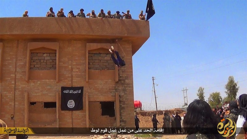 In this file photo released on Jan. 14, 2015, by a militant website, which has been verified and is consistent with other AP reporting, Islamic State militants kill a man they accused of being a homosexual by throwing him off a building in Syria's northeastern province of Hassakeh. (Militant website via AP, File)