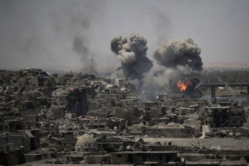 FILE - In this July 11, 2017, file photo, airstrikes target Islamic State positions on the edge of the Old City a day after Iraq's prime minister declared