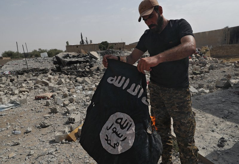 FILE - In this July 17, 2017, file photo, a fighter of the Christian Syriac militia that battles Islamic State group militants under the banner of the U. (AP Photo/Hussein Malla, File)
