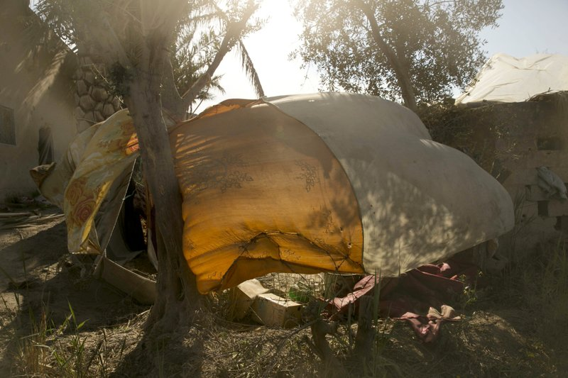 A tent used by Islamic State militants billows in the wind after U.S.-backed Syrian Democratic Forces (SDF) fighters took control of Baghouz, Syria on Saturday, March 23, 2019. (AP Photo/Maya Alleruzzo)