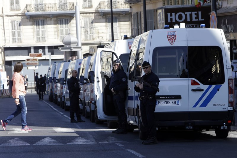 Police officers guard street during a protest in Nice, southeastern France, Saturday, March 23, 2019. (AP Photo/Claude Paris)