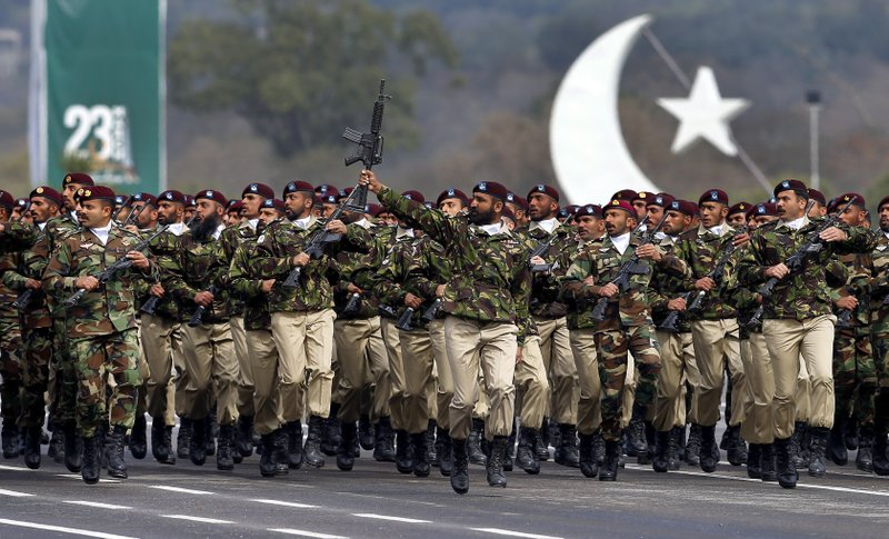 Pakistani commandos from the Special Services Group march during a military parade to mark Pakistan National Day, in Islamabad, Pakistan, Saturday, March 23, 2019. (AP Photo/Anjum Naveed)