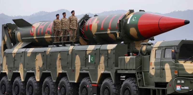 A Pakistani-made Shaheen-III missile, that is capable of carrying nuclear warheads, is loaded on a trailer rolls down during a military parade to mark Pakistan National Day, in Islamabad, Pakistan, Saturday, March 23, 2019. (AP Photo/Anjum Naveed)