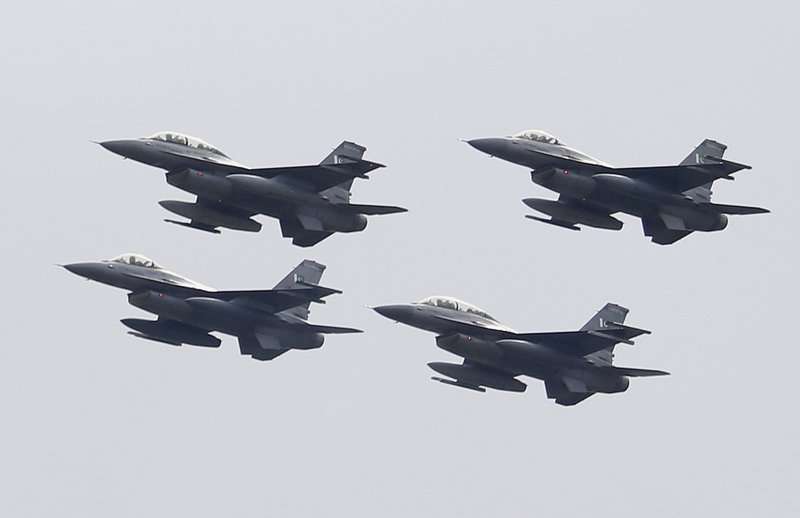 Pakistani Air Force F-16 fighter jets fly in formation during a military parade to mark Pakistan National Day, in Islamabad, Pakistan, Saturday, March 23, 2019. (AP Photo/Anjum Naveed)