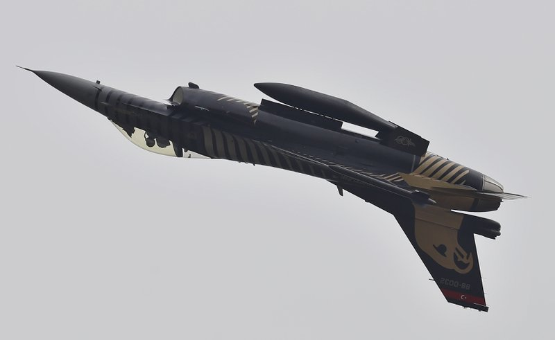 A Turkish fighter jet performs an aerobatic stunt during a military parade to mark Pakistan National Day, in Islamabad, Pakistan, Saturday, March 23, 2019. (AP Photo/Anjum Naveed)