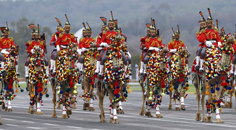 Pakistan army musical band parade on camelback during a military parade to mark Pakistan National Day, in Islamabad, Pakistan, Saturday, March 23, 2019. (AP Photo/Anjum Naveed)