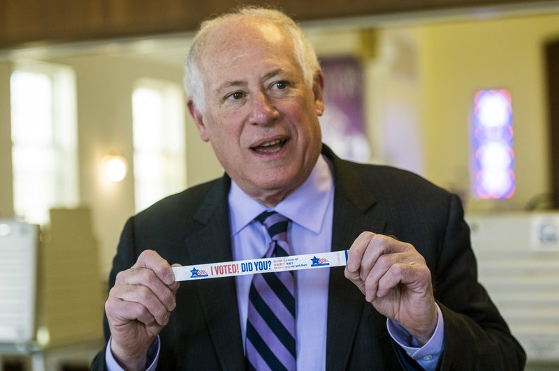 FILE--In this March, 2018 file photo, Former Illinois governor and now Democratic Attorney General candidate Pat Quinn sports one of his famous purple striped ties as he holds up an