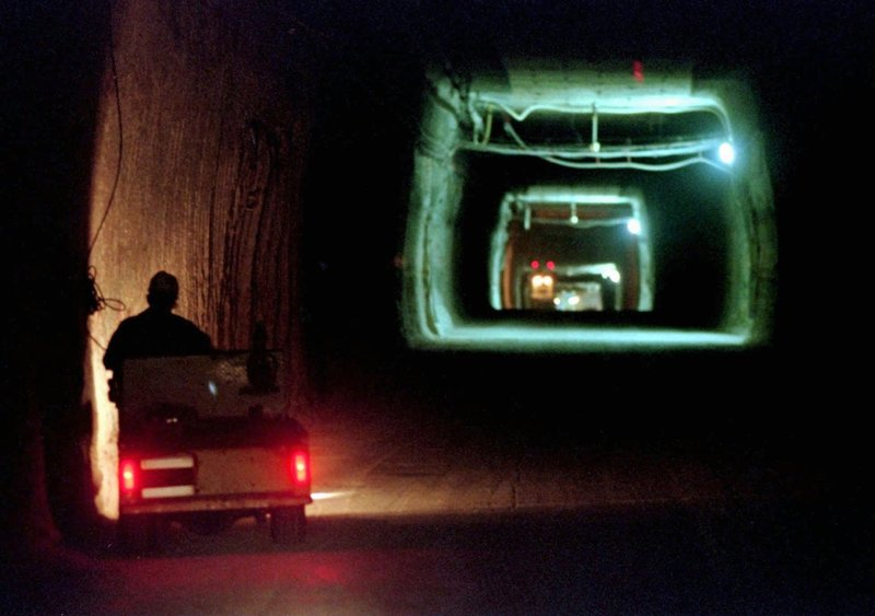FILE - In this April 8, 1998, file photo, a worker drives a cart through a tunnel inside the Waste Isolation Pilot Plant No. (AP Photo/Eric Draper, File)