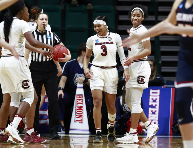 South Carolina guard Destanni Henderson (3) smiles after being fouled while facing Belmont in a first-round game in the NCAA women's college basketball tournament in Charlotte, N. (AP Photo/Jason E. Miczek)