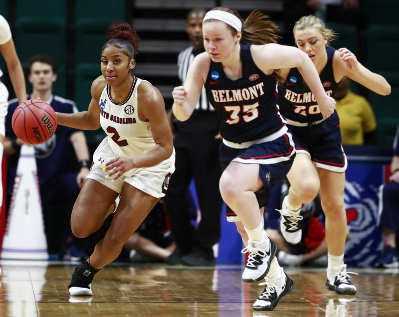 South Carolina guard Te'a Cooper (2) drives upcourt after stealing the ball from Belmont's Conley Chinn, right, during a first-round game in the NCAA women's college basketball tournament in Charlotte, N. (AP Photo/Jason E. Miczek)