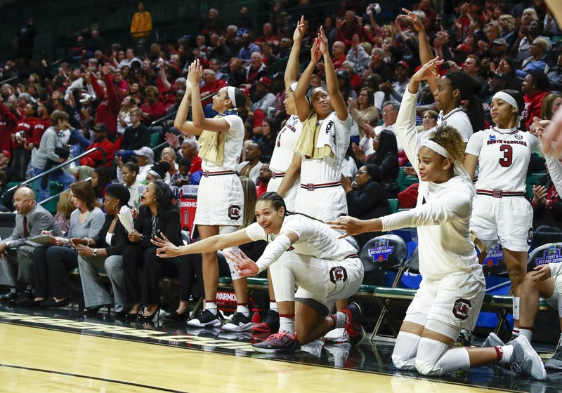 The South Carolina bench reacts at the end of the game after defeating Belmont 74-52 in a first-round game in the NCAA women's college basketball tournament in Charlotte, N. (AP Photo/Jason E. Miczek)