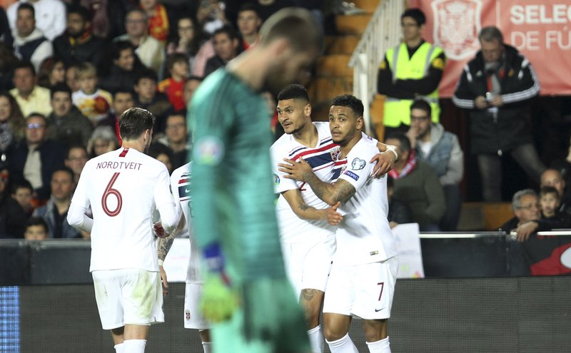 Norway's Joshua King, right, celebrates with his teammates after scoring his side's opening goal during the Euro 2020 group F qualifying soccer match between Spain and Norway at the Mestalla stadium in Valencia, Spain, Saturday, March 23, 2019. (AP Photo/Alberto Saiz)