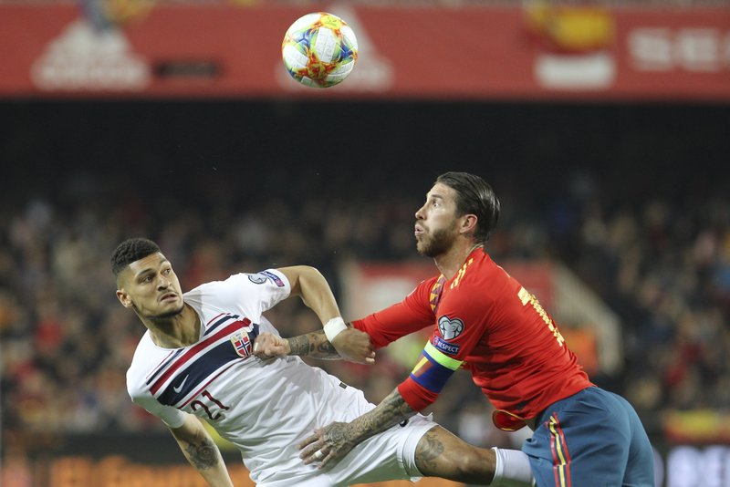 Spain's Sergio Ramos, right, challenges for the ball with Norway's Bjorn Johnsen during the Euro 2020 group F qualifying soccer match between Spain and Norway at the Mestalla stadium in Valencia, Spain, Saturday, March 23, 2019. (AP Photo/Alberto Saiz)
