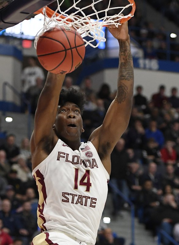 Florida State's Terance Mann (14) dunks the ball during the first half of a second round men's college basketball game against Murray State in the NCAA tournament, Saturday, March 23, 2019, in Hartford, Conn. (AP Photo/Jessica Hill)
