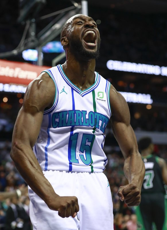 Charlotte Hornets guard Kemba Walker reacts after scoring and getting fouled by the Celtics in the second half of an NBA basketball game Saturday, March 23, 2019, in Charlotte, N. (AP Photo/Jason E. Miczek)