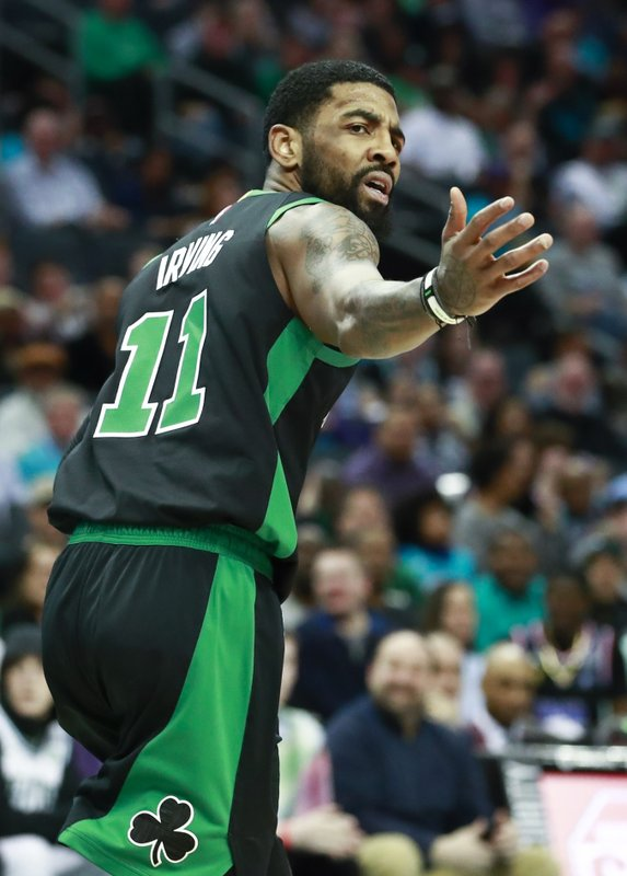 Boston Celtics guard Kyrie Irving reacts after a referee call while facing the Charlotte Hornets in the first half of an NBA basketball game Saturday, March 23, 2019, in Charlotte, N. (AP Photo/Jason E. Miczek)
