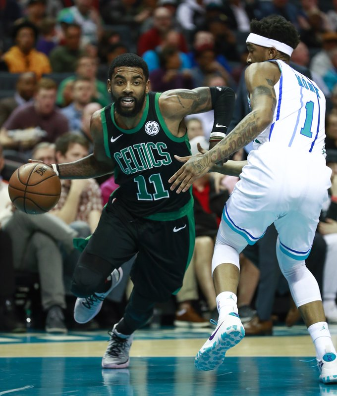 Boston Celtics guard Kyrie Irving (11) moves past Charlotte Hornets defender Mailik Monk in the first half of an NBA basketball game Saturday, March 23, 2019, in Charlotte, N. (AP Photo/Jason E. Miczek)