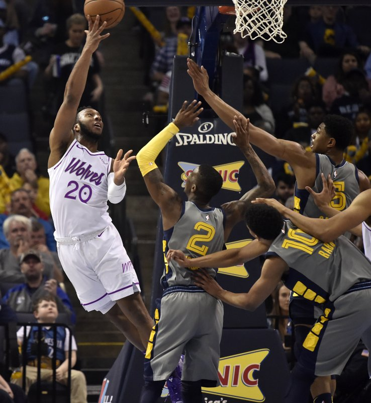 Minnesota Timberwolves guard Josh Okogie (20) shoots against Memphis Grizzlies guard Delon Wright (2), and forwards Ivan Rabb (10), and Bruno Caboclo (5) in the first half of an NBA basketball game Saturday, March 23, 2019, in Memphis, Tenn. (AP Photo/Brandon Dill)