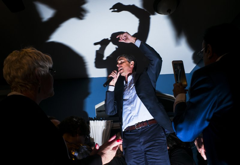 Democratic presidential candidate and former Texas congressman Beto O'Rourke addresses a gathering during a campaign stop at a home in Las Vegas on Saturday, March 23, 2019. (Chase Stevens/Las Vegas Review-Journal via AP)