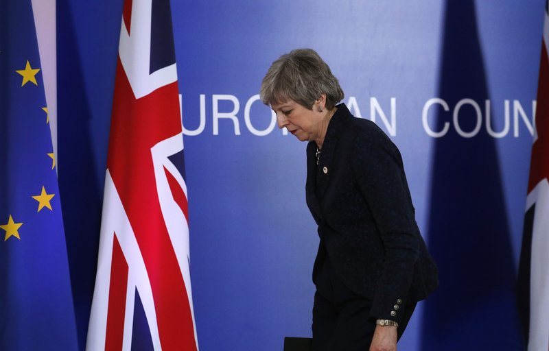 British Prime Minister Theresa May leaves after addressing a media conference at an EU summit in Brussels, Friday, March 22, 2019. (AP Photo/Frank Augstein)