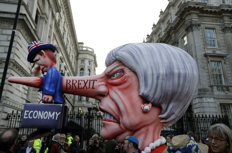 An effigy of British Prime Minister Theresa May passes by Downing Street during a Peoples Vote anti-Brexit march in London, Saturday, March 23, 2019. (AP Photo/Kirsty Wigglesworth)