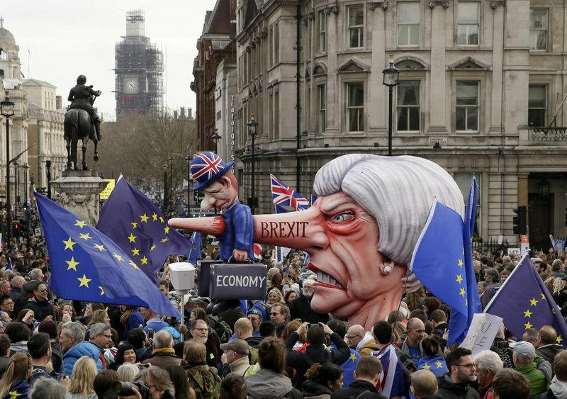 An effigy of British Prime Minister Theresa May is wheeled through Trafalgar Square during a Peoples Vote anti-Brexit march in London, Saturday, March 23, 2019. (AP Photo/Tim Ireland)