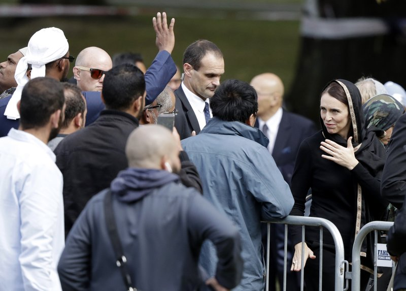 New Zealand Prime Minister Jacinda Ardern, right, gestures as she leaves Friday prayers at Hagley Park in Christchurch, New Zealand, Friday, March 22, 2019. (AP Photo/Mark Baker)