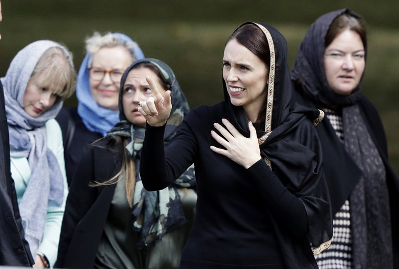 New Zealand Prime Minister Jacinda Ardern, second right, gestures as she leaves Friday prayers at Hagley Park in Christchurch, New Zealand, Friday, March 22, 2019. (AP Photo/Mark Baker)