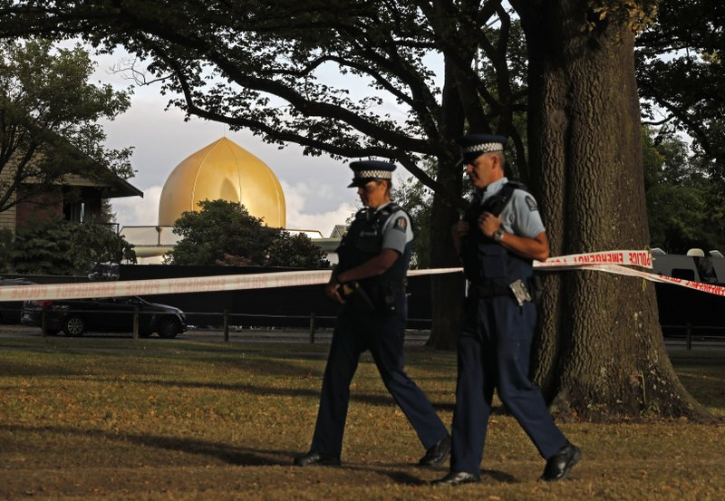 Police officers patrol at a park outside the Al Noor mosque in Christchurch, New Zealand, Wednesday, March 20, 2019. (AP Photo/Vincent Yu)