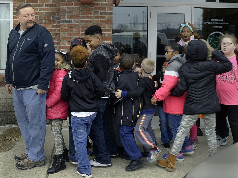 Mike Anderson, left, gets his van full of kids in line to enter the LaBelle Theatre in South Charleston, W. (F. Brian Ferguson/Charleston Gazette-Mail via AP)