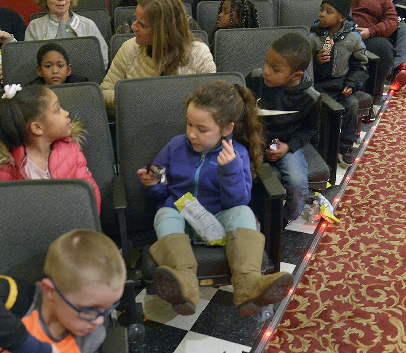 In this Feb. 28, 2019 photo, Children snack as they wait for the show at the LaBelle Theatre in South Charleston, W. (F. Brian Ferguson/Charleston Gazette-Mail via AP)