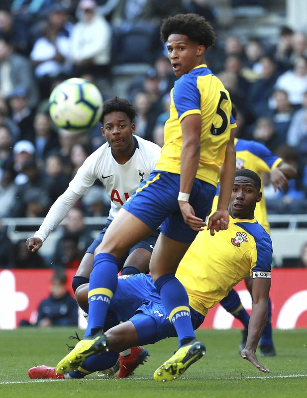 J'Neil Bennett, left, scores his side's first goal of the game against Southampton, during the U18 Premier League test event match at Tottenham Hotspur Stadium in London, Sunday March 24, 2019. (Ian Walton/PA via AP)