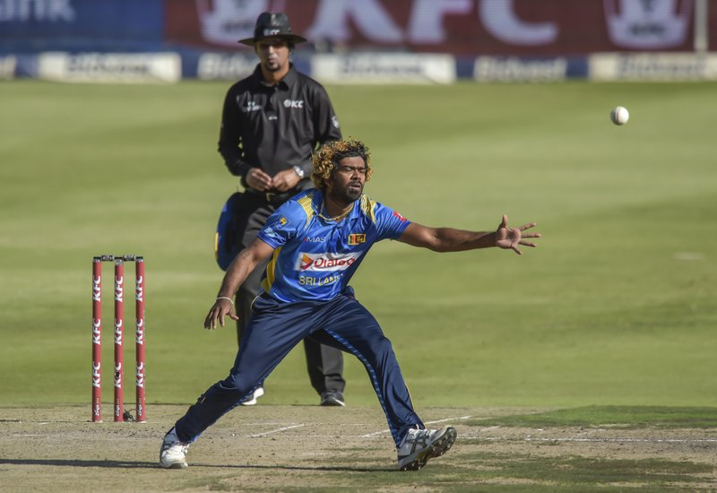 Sri Lanka's captain Lasith Malinga fielding a ball from his own bowling during the T20I match between South Africa and Sri Lanka at Wanderers Stadium in Johannesburg, South Africa, Sunday, March 24, 2019. (AP Photo/Christiaan Kotze)