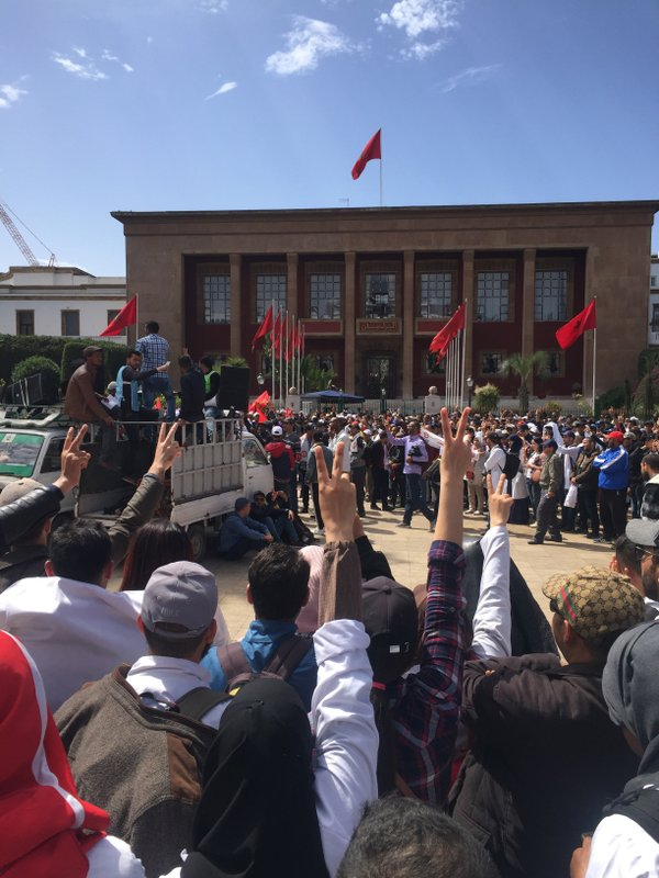 Thousands of Moroccan teachers shout in front of the Moroccan Parliament during a protest and the latest outbreak of anger at low-wage, temporary teaching contracts in Rabat, Morocco, Sunday March 24, 2019. ( AP Photo/Amira El Masaiti)