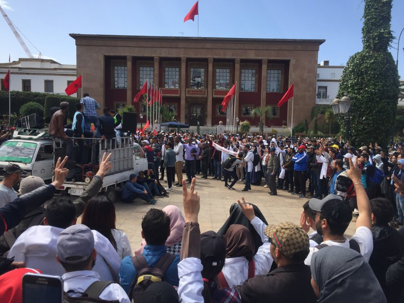 Thousand of Moroccan teachers shout in front of the Moroccan Parliament during a protest and the latest outbreak of anger at low-wage, temporary teaching contracts in Rabat, Morocco, Sunday March 24, 2019. ( AP Photo/Amira El Masaiti)