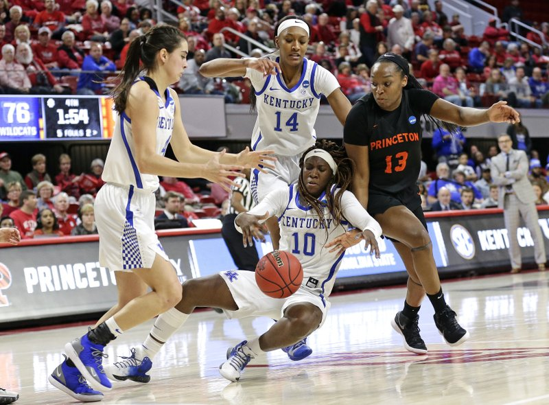 Kentucky's Maci Morris, left, Tatyana Wyatt (14) and Rhyne Howard (10) chase the ball with Princeton's Sydney Jordan (13) during the second half of a first-round game in the NCAA women's college basketball tournament in Raleigh, N. (AP Photo/Gerry Broome)