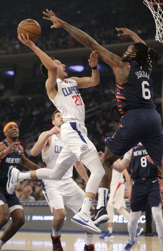 Los Angeles Clippers Landry Shamet, left, is defended by New York Knicks DeAndre Jordan (6) during the first half of an NBA basketball game, Sunday, March 24, 2019, in New York. (AP Photo/Seth Wenig)