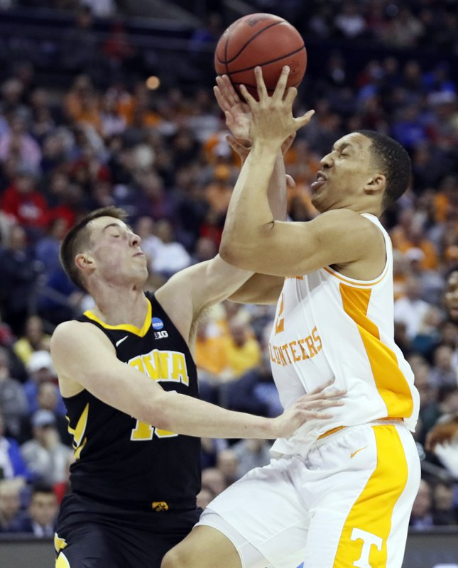 Tennessee's Grant Williams, right, drives to the basket against Iowa's Joe Wieskamp in the first half during a second-round men's college basketball game in the NCAA Tournament in Columbus, Ohio, Sunday, March 24, 2019. (AP Photo/John Minchillo)