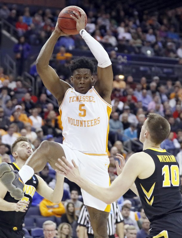 Tennessee's Admiral Schofield (5) grabs a rebound ahead of Iowa's Joe Wieskamp (10) in the first half during a second round men's college basketball game in the NCAA Tournament in Columbus, Ohio, Sunday, March 24, 2019. (AP Photo/John Minchillo)