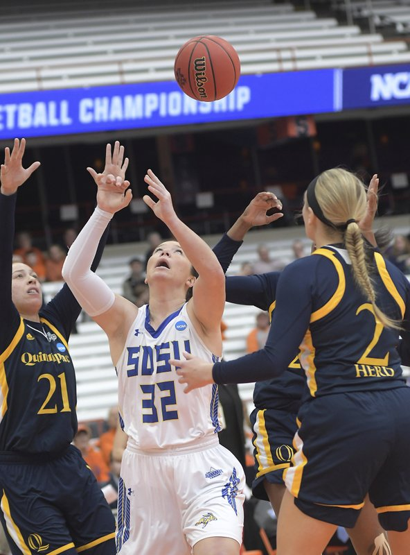 South Dakota State's Sydney Palmer (32) keeps her eye on the ball against Quinnipiac during of a first-round game in the NCAA women's college basketball tournament in Syracuse, N. (AP Photo/Heather Ainsworth)