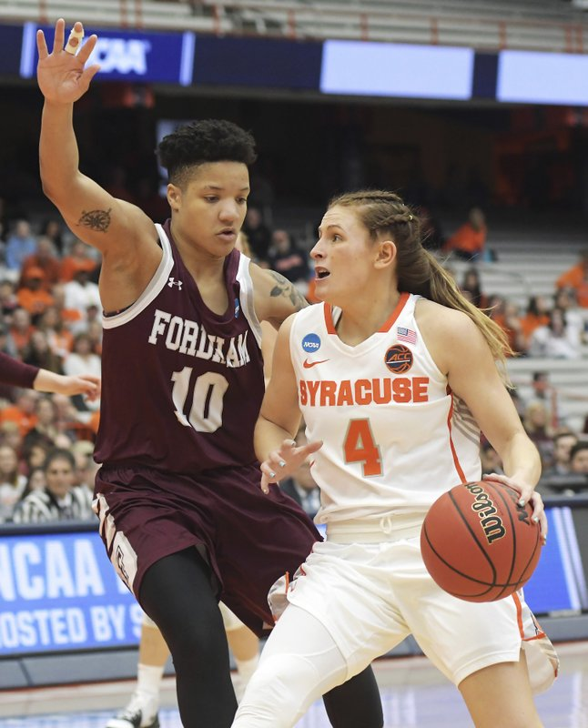 Syracuse's Tiana Mangakahia (4) drives towards the basket as Fordham's Bre Cavanaugh defends during of a first-round game in the NCAA women's college basketball tournament in Syracuse, N. (AP Photo/Heather Ainsworth)
