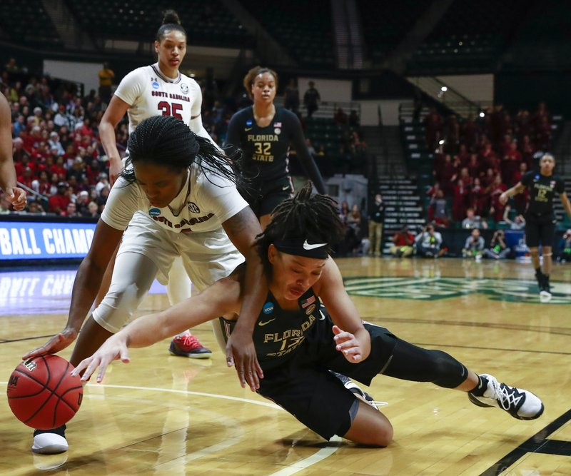 South Carolina guard Doniyah Cliney, left, and Florida State guard Nausla Woolfolk, right, battle for the ball during the first half of a second-round women's college basketball game in the NCAA Tournament in Charlotte, N. (AP Photo/Jason E. Miczek)