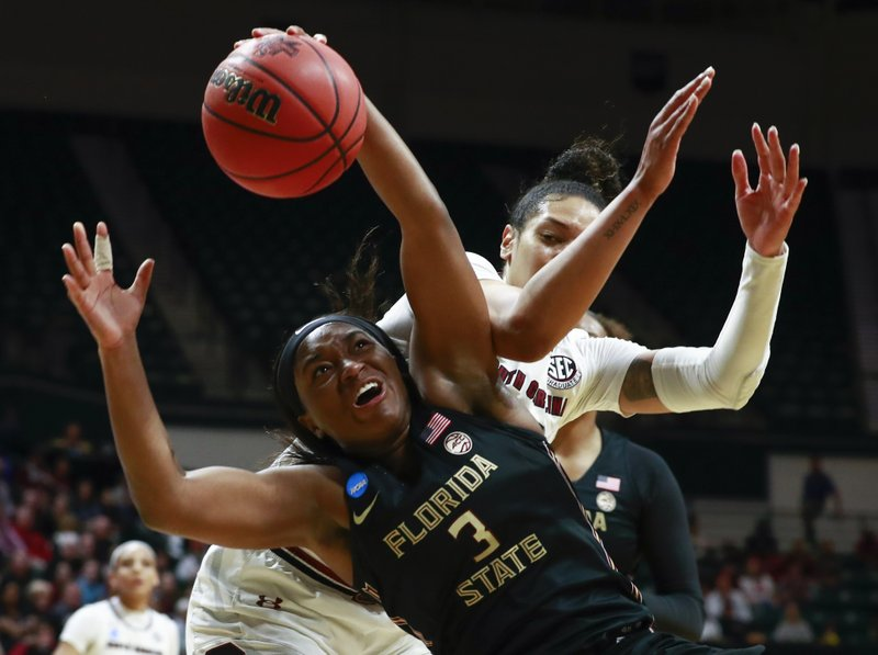 Florida State guard Sayawni Lassiter (3) battles for the ball with South Carolina defender Alexis Jennings, right, during the first half of a second-round women's college basketball game in the NCAA Tournament in Charlotte, N. (AP Photo/Jason E. Miczek)