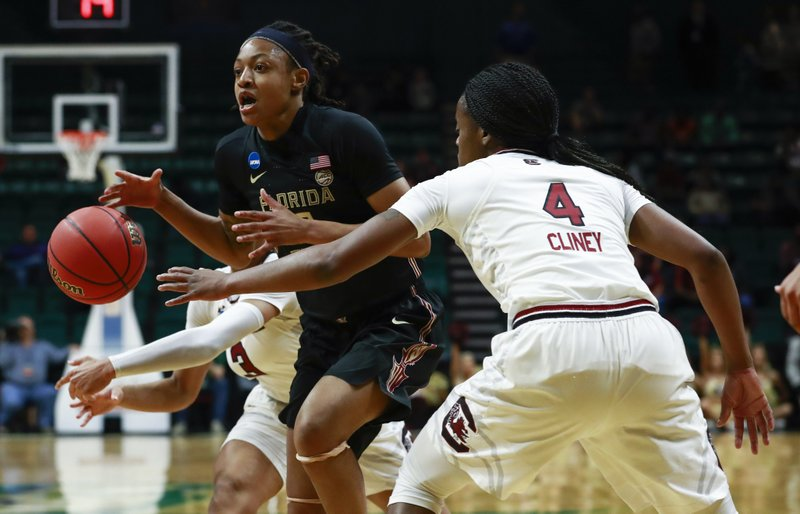 Florida State guard Nicki Ekhomu, front left, tries to pass around South Carolina defender Doniyah Cliney (4) during the first half of a second-round women's college basketball game in the NCAA Tournament in Charlotte, N. (AP Photo/Jason E. Miczek)