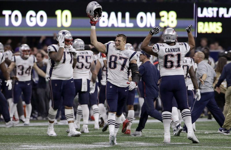 FILE - In this Feb. 3, 2019, file photo, New England Patriots' Rob Gronkowski (87) celebrates with teammates after the NFL Super Bowl 53 football game against the Los Angeles Rams in Atlanta. (AP Photo/Carolyn Kaster, File)